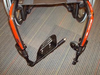 Flip up footrest