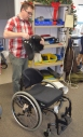 Custom moulded plastic backrest mounted on wheelchair