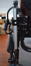 Mounting bracket on back of wheelchair