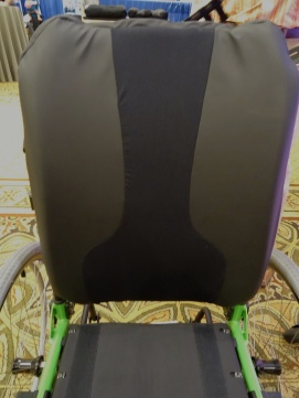 Front of backrest, stretchy material for spinous processes