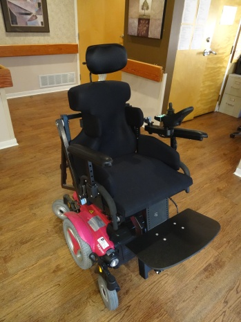 Custom power wheelchair transfer system in driving position
